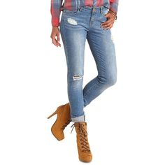Boys are cute and all, but the Refuge Boyfriend jeans willreallytreat a girl right! Thick, medium wash denim does distressing to perfection, with major rips …