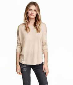 Soft, fine-knit sweater in a loose fit. Wide neckline, dropped shoulders, and long sleeves. Slightly longer at back.