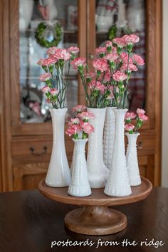 milk glass vases with carnations