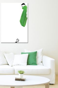 Revamping the living space with this chic and so stylish canvas art of a woman in a green coat.