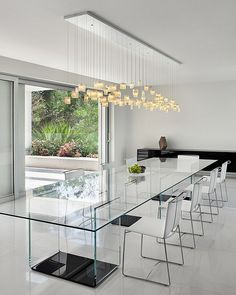 Contours of the Tulip Chandelier complement the form of the rectangular dining table - Decoist