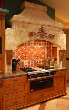 This is one of the coolest stove tops remodels I've seen in a long time. It almost makes me think of a old Spanish mission with the way the top is done. That and the tile work in the back just really add a ton of spice to the kitchen area! This is totally my dream kitchen and I'll be updating as soon as possible.
