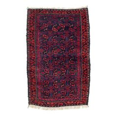 """Baluch Balisht  Second half 19th century, 80 x 52 cm, North East Persia, Khorasan  Known as """"balisht"""", small rugs in an elongated format were woven by many Baluchi tribes. Originally joined to a kilim back and stitched together at the sides, they were used as cushions or containers."""