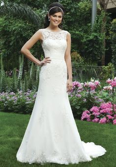 A lace and tulle sheer wedding dress from Sincerity Bridal. With V-back and buttons that cover the back zipper and chapel length train // 3730