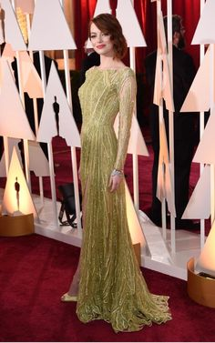 Emma Stone's pale green beaded Elie Saab gown for the 2015 Oscars was a masterclass in colour-matching for redheads and certified Miss Stone's status as a red carpet winner Vestidos Elie Saab, Elie Saab Gowns, Best Oscar Dresses, Iconic Dresses, Oscars Red Carpet Dresses, Red Carpet Gowns, Prom Dresses Long With Sleeves, Nice Dresses, Estilo Emma Stone