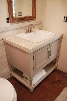 """How to build a vanity from scratch. ALSO: a bit about """"glazing"""" -- The base color: Benjamin Moore Valley Forge Tan (which is also the base color for the weathered white wood boards), the glaze was a random sample from Lowes — I believe its Olympic """"Granite"""" — and it was mixed w/ about two parts clear glaze to one part paint or less to do the top coat."""