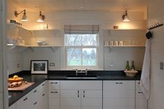 A wider view of architect Sheila Narusawa's Harbor Cottage kitchen with soapstone counters. Image by Justine Hand.