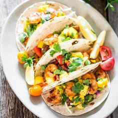 Cajun Shrimp Tacos with Mango Salsa - the easiest and most delicious shrimp tacos with a super easy, fresh and delicious mango salsa. So satisfying, and so fresh!