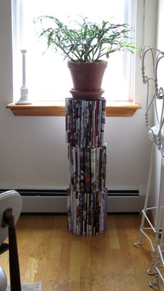 How about a plant stand from old magazines?  Instructions included.
