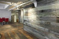 Antique barn wood siding created the cool, reclaimed wall paneling in this office. #decor #reclaimed #recycled
