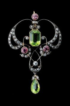 Art Nouveau peridot, tourmaline, diamond, sterling silver, and gold pendant.