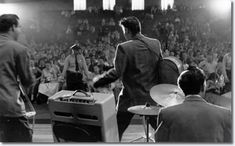 Bill Black, Elvis Presley and DJ Fontana performing during first show in the fieldhouse - May 27, 1956