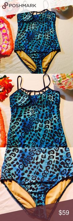 """⚡️SALE⚡️NWOT Athena Cheetah Strappy One Piece Suit Brand New Without Tags. Beautiful Blue/Black Cheetah With A Super Shimmering Golden Colored Inside!!! Underwire And Padded Bra Make This One Piece Swimsuit A Perfect Fit!!! Paradise Ready 🌴🌴🌺🌺 Measurements: Approx 16"""" Flat From Pit To Pit. Womens Size 10 Athena Swim One Pieces"""