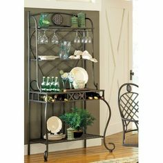 Steve Silver Company Steve Silver Wimberly Bakers Rack by Steve Silver Company. $200.52. Metal Base/Rich Multi-Step Dark Cherry Finish. Wine Glass Storage. Contemporary Style. Sturdy gauge metal. Wine Bottle Storage. The Wimberly bakers rack is sure to exceed expectations and is versatile enough to match any homes décor. The Wimberly bakers rack features a decorative metal design enhanced by a beautiful diamond planked working surface and woven metal accents. Th...