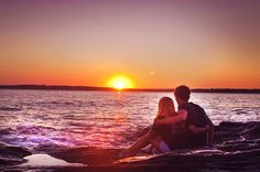 sitting on the beach at sunset with him