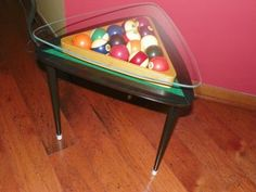 I found a pair of triangle tables at a flea market. I painted them, added green felt, old pool balls and rack. I had the glass tops cut to fit the table. They look great in my game room!