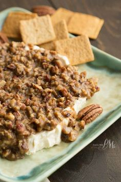 This is decadent! My family complains now when I don't bring it. French Quarter Pecan Cheese Spread Recipe - praline pecan topping smothers a seasoned cream cheese mixture. Pecan Recipes, Cooking Recipes, Dip Recipes, Cheese Recipes, Keto Recipes, Appetizer Dips, Appetizer Recipes, Guacamole, Hummus