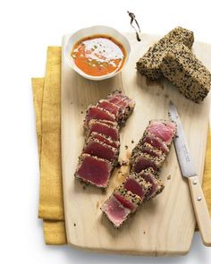 A generous sesame seed crust amplifies the nutritional value of tuna -- and adds an appealing texture that offsets the softer mouthfeel of the seared tuna. A citrusy and spicy dipping sauce with notes of mirin, miso, ginger, orange juice, and carrot juice enhances the dish without adding excess calories.