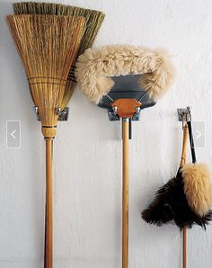 great idea to organize mops and brooms