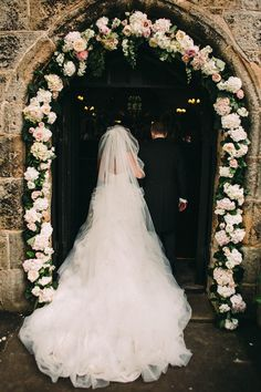 Ian Stuart Pracatan Ruffle Wedding Dress | Flower Arch | Lawson Photography | http://www.rockmywedding.co.uk/rebecca-jamie/