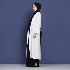 INAYAH | Essential black and white pieces for everyday wear. Available online and in-store: Off-white Belted #Maxi Coat + Maxi Black Cotton Slip #Dress + Black Maxi Georgette #Hijab - www.inayah.co