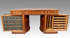 "Sold for $3,750 in Dec. 2010.     Rare 19th C. American Walnut Wooten's Rotary Desk Flat top Victorian Desk made by the self proclaimed King of Desk Makers. It has a tag marked ""Wooton's Rotary Desk, patented."" Each side of the desk swings out providing organized filing space. Walnut Burl Wood  was used on all sides of the desk. Original Victorian Hardware and Red Leather Top. Desk measures 32.5"" x 60."" The desk is 31 "" tall. 86"" wide when opened.   All cubbyhole inserts appear to be original"
