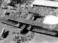 The unveiling of Germany's newest bomber, June 28, 1917. The Zeppelin-Staaken R.VI's wingspan was 138 ft., rivaling the Boeing Superfortress of World War II. One of the first airplanes to have an enclosed cockpit, the R.VI was designed to bomb cities...
