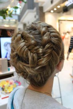 Try a new look with a wrap around fishtail braid
