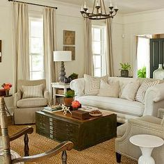 Southern Living - living rooms - seagrass, rug, file cabinet, coffee table, white, chesterfield, sofa, mitered, pillows, camel, linen, accent chairs, gray, gourd, lamp, iron, chandelier, file coffee table, file cabinet coffee table, industrial coffee table,