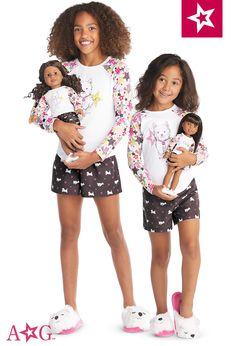 Just like the doll-sized version, this comfy pajama top features an allover colorful star print on the raglan sleeves, plus a graphic of Coconut the pup and the American Girl logo. And she can stay cool under the covers in shorts with a Coconut and American Girl star print. Flame-resistant polyester. Imported. Sizes 4-20.
