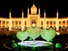 Copenhagen Denmark  Tivoli Gardens opened in 1843.  Extravagant light show.  The Christmas light show illuminates Tivoli Lake.