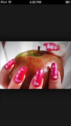 That apple is like a perfect thing to hold with those nails!! ;)