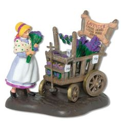 Department 56 Dickens Village Series Lavender Costermonger -- Learn more by visiting the image link. (This is an affiliate link) Christmas In The City, Christmas Home, Christmas Ornaments, Dept 56 Dickens Village, Department 56, How To Show Love, Collectible Figurines, Colorful Pictures, Chelsea