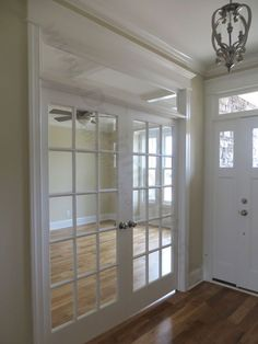 Double door add privacy to this designs flex space. How would you use the space? Home office? Formal Dining room? Study pace for home-schooling? The nice thing about 'flex' spaces is you decide how the space is used!