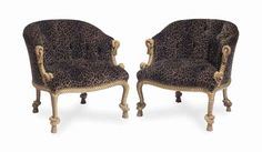 A set of four giltwood rope-twist carved club chairs covered in…