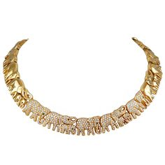 CARTIER Diamond Gold ' Jumbo' Elephant Necklace | From a unique collection of vintage choker necklaces at https://www.1stdibs.com/jewelry/necklaces/choker-necklaces/