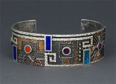 Cuff | Ric Charlie (Navajo).  Sterling silver with multi-stone inlay of  turquoise, lapis, coral and sugilite with patinas