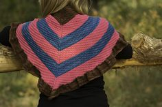 Laudine Shawl from KarenDawn Designs: This elongated triangular shawl begins with a garter tab cast on and works its way out from the center, increasing every row. Using three colors reveals a chevron pattern and the final section uses a ruffle. Worked in a worsted weight yarn with knits and purls, this is a shawl to keep you warm and cozy on a cold day (perhaps snuggle up in a comfy chair with a good book?). Click to buy now or repin to save for later.