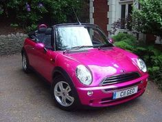 Hot pink convertible Mini Cooper.  Be still my heart.