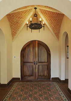 Saltillo tile entry further embellished with a cement tile rug. Via Vanguard Studio Inc.