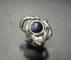 Entwined Serpents Ring - sculpted sterling silver ring with two snakes winding around each other. The ring in the photo is set with blue goldstone, but it