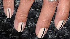 Mariqueen Maandig's nails. Nude polish with thin black stripe.