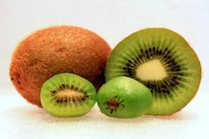 Did you know there was such a thing as a grape kiwi (aka baby kiwi, kiwi berry, or hardy kiwi)?! Is it possible to get almost fan-girl squeely over a plant? Did you know that this kiwi not only comes in green and red, it grows in temperate zones? Oh yes folks! I can grow a kiwi in zone 6. A teeny tiny kiwi that you do not even have to peel! There are actually larger hardy kiwi's, but this post isn't about them. This is about the adorable grape kiwis. The Low Down on Grape Kiwi's Grape Kiwis…