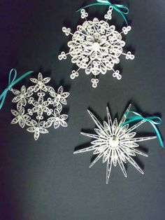more quilled snowflakes. These would make gifts for children just add their names to the centre and they'd have their own personalised tree decoration
