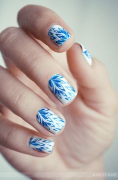 Blue and white pattern nails.