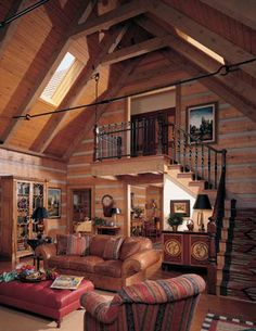 Vaulted great room with skylights #loghome #log cabin