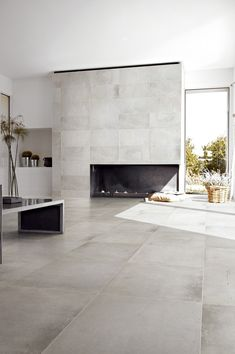 modern flooring Minimalist living area with gray ceramic floor tiles and modern fireplace Ceramic Wood Tile Floor, Concrete Look Tile, Wood Tile Floors, Porcelain Tiles, Concrete Floors In House, Concrete Kitchen Floor, Concrete Bathroom, Plywood Floors, Concrete Houses