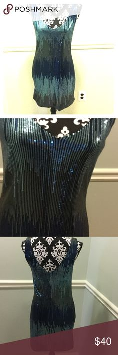 Gorgeous all over sequin evening dress. This beautiful all over sequin dress in graduating shades of blues is stunning v neck front and back. No zipper. As U Wish Dresses
