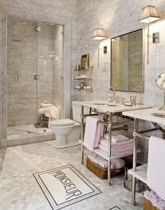A Grand, Parisian Hotel-Inspired Guest Bathroom . An antique chandelier, a burnished cast-iron tub, silver decor, and a vintage pharmacy cabinet give the bathroom in designer Betty Lou Phillips's home its luxurious French style. Love the rugs French Bathroom Decor, Parisian Bathroom, Modern Master Bathroom, Vintage Bathrooms, Neutral Bathroom, Glamorous Bathroom, Luxury Bathrooms, Small Bathrooms, Bathroom Interior