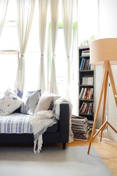 While reducing clutter and ensuring your furniture is proportional are probably no-brainers, a lesser-known strategy is to use curtains and window treatments to trick the eye — and don't let small windows limit you. Bohemian Living Rooms, Living Room Decor, Living Spaces, Rental Kitchen, Home Staging, Apartment Therapy, Apartment Ideas, Luxury Homes, Sweet Home